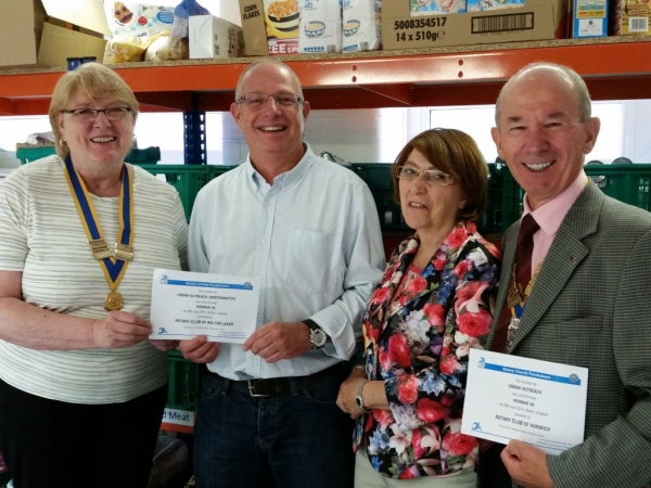 Rotary Clubs Join Together for Presentation to Bolton Charity