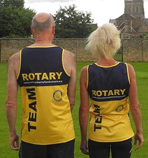 Rotarians Stewart Cursley & Rachel Goodfellow in the TEAM Rotary Running Vest (Back)
